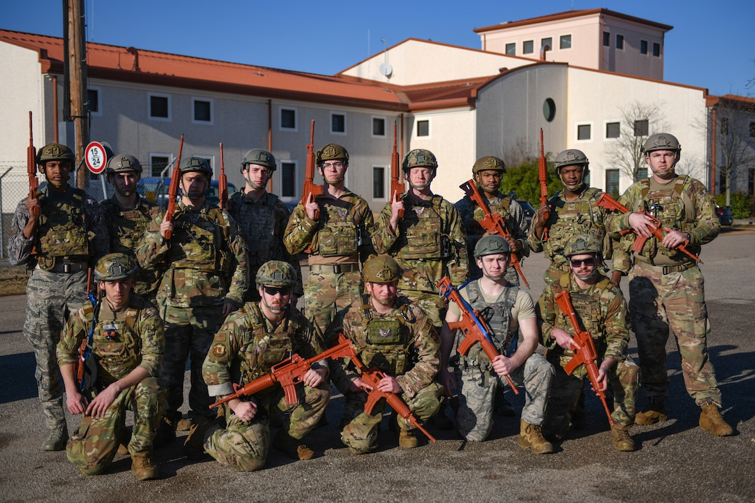 U.S. Airmen from the 31st Security Forces Squadron pose for a photo at Aviano Air Base, Italy, Feb. 14, 2020. The 31st SFS maintains installation force protection during peacetime and wartime operations within eight separate base areas. (U.S. Air Force photo by Airman 1st Class Ericka A. Woolever)
