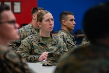 U.S. Marine Corps Sgt. Kyere Trent with 2nd Marine Logistics Group, sits in a Sergeant Symposium on Camp Lejeune, N.C. Feb.12, 2020. The symposium was held to encourage and develop sergeants through mentorship of senior leaders. (U.S. Marine Corps photo by Lance Cpl. Scott Jenkins)