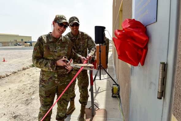 Col. Tara White, 379th Expeditionary Mission Support Group commander, and Maj. Jason Gargan, 379th Expeditionary Communications Squadron commander, cut a ribbon to commemorate the relocation of the wing's communication security office at Al Udeid Air Base, Qatar on Feb. 2, 2020. The new location is designed to enhance security and access for more than 40 unit account holders and 1,400 customers who rely on encrypted communication to conduct their missions throughout the U.S. Central Command area of responsibility. (U.S. Air Force photo by Tech. Sgt. John Wilkes)