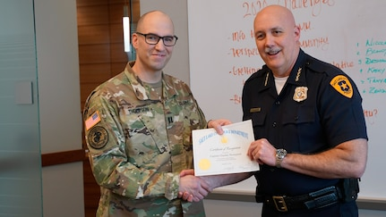 """Capt. Charles Thompson, a full-time victim advocate for Utah National Guard's Family Programs was recognized by Salt Lake City Police Department Chief Mike Brown during a command staff meeting at the Public Safety Building in Salt Lake City, """"for going beyond the call of duty,"""" Feb. 12, 2020."""