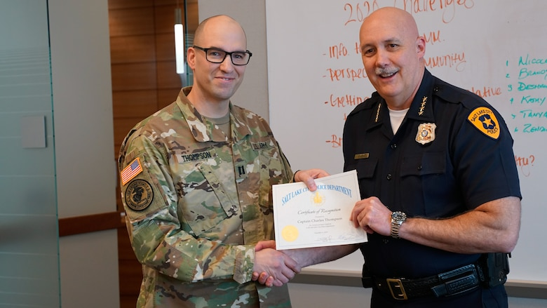 "Capt. Charles Thompson, a full-time victim advocate for Utah National Guard's Family Programs was recognized by Salt Lake City Police Department Chief Mike Brown during a command staff meeting at the Public Safety Building in Salt Lake City, ""for going beyond the call of duty,"" Feb. 12, 2020."