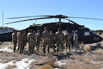 New Mexico National Guard medics learn how to prepare and load patients for medical evacuation in Rio Rancho Feb. 13, 2020. The instruction was part of the NMNG's medic recertification course.