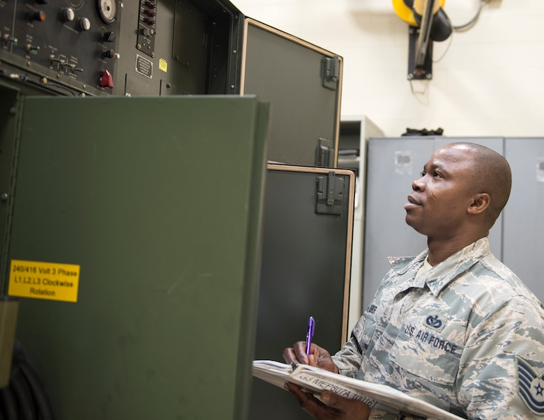U.S. Air Force Tech. Sgt. Kokou Azalekor, an electrical power production technician with the 133rd Civil Engineer Squadron, records information onto a generator log in St. Paul, Minn., Feb. 12, 2020.
