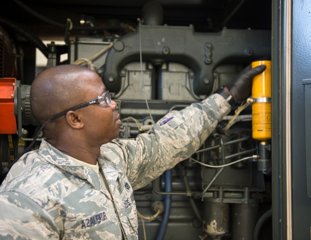 U.S. Air Force Tech. Sgt. Kokou Azalekor, an electrical power production technician with the 133rd Civil Engineer Squadron, replaces the engine start fluid cylinder in St. Paul, Minn., Feb. 12, 2020.