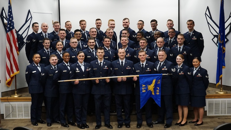 The graduates of Airman Leadership Class 20-B pose for a group photo.