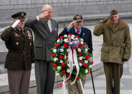 Army Gen. Mark A. Milley, chairman of the Joint Chiefs of Staff, and special guests participate in a ceremony and wreath presentation at the National World War II Memorial in Washington, D.C. to mark the 75th anniversary of the Battle of Iwo Jima. The 36 day-battle was part of a U.S. amphibious assault to capture the Japanese-held island of Iwo Jima, and resulted in a hard-fought American victory. Gen. Milley's father, a Navy Corpsman with 4th Marine Division, was among the Marines who fought in the Battle of Iwo Jima.