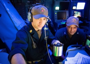 Sailors in the mission control center aboard the Freedom-class littoral combat ship USS Little Rock.