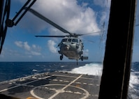 A helicopter takes off from USS Little Rock (LCS 9)