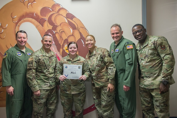 "Senior Airman Sandra Troncoso, 47th Operations Support Squadron host aviation resource management (HARM) technician, was chosen by wing leadership to be the ""XLer"" of the week, Feb. 10, 2020, at Laughlin Air Force Base, Texas. The ""XLer"" award, presented by Col. Lee Gentile, 47th Flying Training Wing commander, and Chief Master Sgt. Brian Lewis, 47th Operations Group superintendent, is given to those who consistently make outstanding contributions to their unit and the Laughlin mission. (U.S. Air Force photo by Senior Airman Daniel Hambor)"