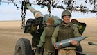 Romanian Soldiers provide artillery support at 1st Cavalry Division's Combined Arms Live Fire Exercise