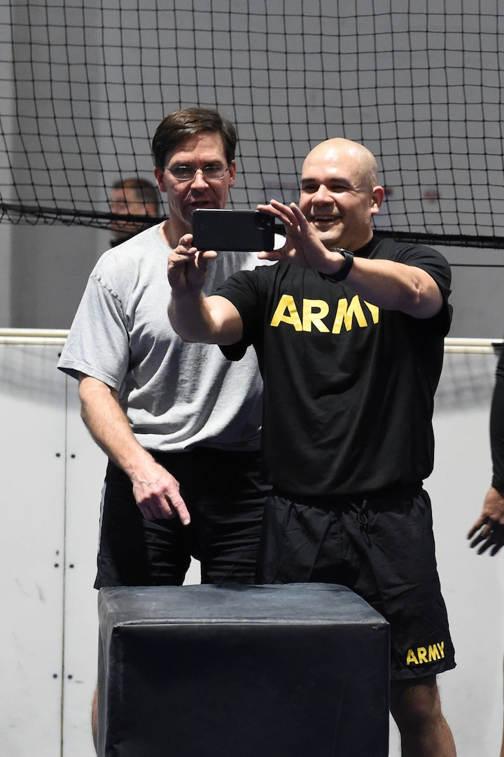 "Secretary of Defense Dr. Mark T. Esper takes a ""selfie"" with U.S. Army Col. Joe Guzman following physical training at Offutt Air Force Base, Neb., Feb. 20, 2020. Esper participated in circuit training with more than 40 USSTRATCOM and 55th Wing service members, following up the workout with a question and answer session."