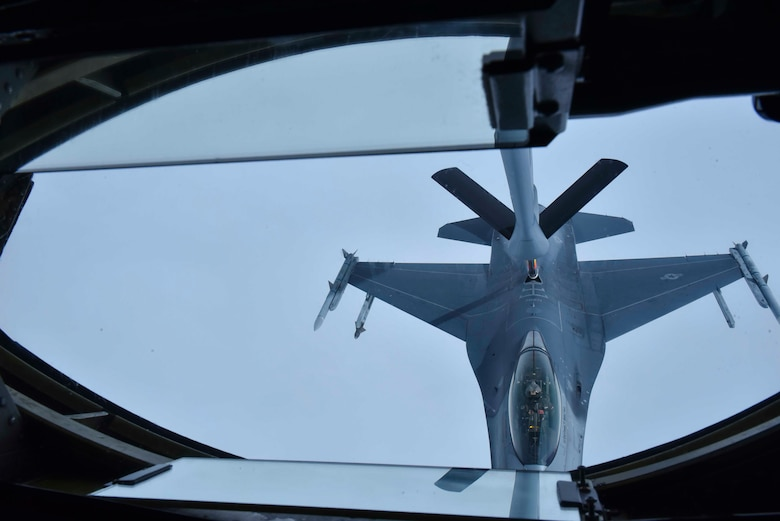 A Fairchild Air Force Base KC-135 Stratotanker refuels a Maxwell Air Force Base F-16 Fighting Falcon from the Red Tail Squadron of the 187th Fighter Wing from while flying over Alabama, February 18, 2020. The Red Tail Squadron was home to the Tuskegee Airmen, the first all-black squadron in the U.S. military. (U.S. Air Force photo by Airman 1st Class Kiaundra Miller)