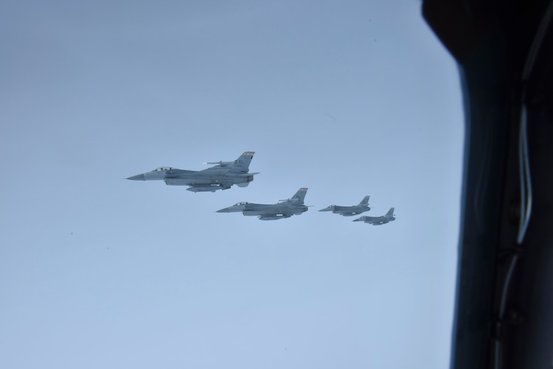 Four F-16 Falcons of the Red Tail Squadron from the 187th Fighter Wing, Maxwell Air Force Base, Alabama, fly in formation next to a Fairchild Air Force Base KC-135 Stratotanker over Montgomery, February 18, 2020. The flight took place to represent black military heritage and provide tribute to the WWII Tuskegee Airmen, who played a significant wartime role and paved the way for minority representation in today's Air Force. (U.S. Air Force photo by Airman 1st Class Kiaundra Miller)