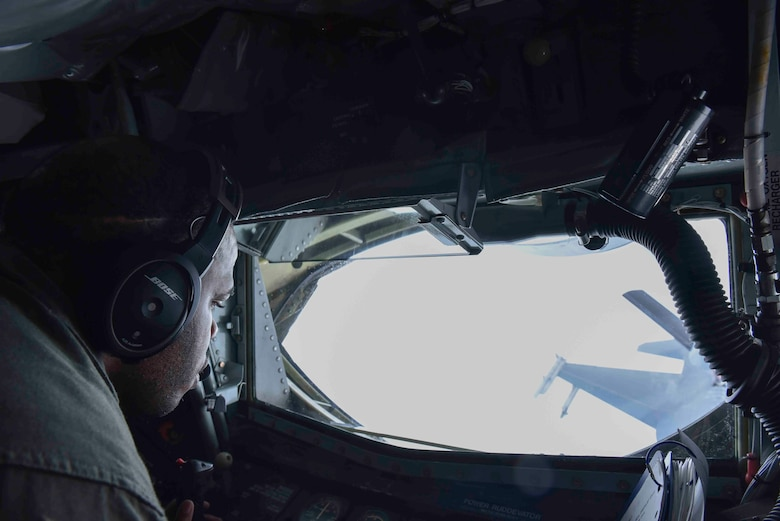 U.S. Air Force Tech. Sgt. Jonathon Rogers, 93rd Air Refueling Squadron boom operator, performs air refueling maneuvers with an F-16 Fighting Falcon from the Red Tail Squadron of the 187th Fighter Wing while flying over Alabama, February 18, 2020. Every F-16 that participated in the air refueling was piloted by a black Airman from the Tuskegee Airmen's honorary 'Red Tail' Squadron. (U.S. Air Force photo by Airman 1st Class Kiaundra Miller)