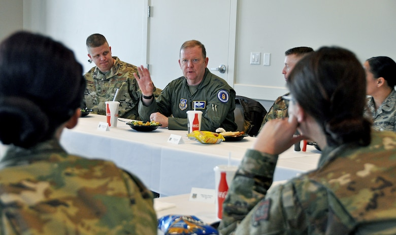 Lt. Gen. Richard Scobee, Air Force Reserve Command commander and chief of the Air Force Reserve, talks with reservists in the 419th Fighter Wing