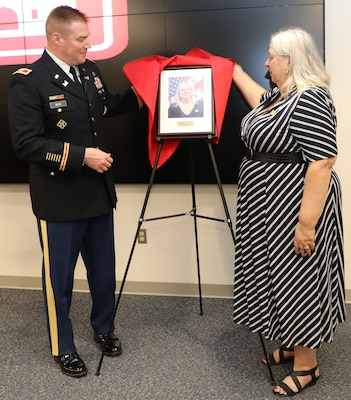 "Transatlantic Division Commander Col. Christopher Beck and Inductee Jo-Ann Evans unveil her portrait that will hang in TAD's ""Gallery of Distinguished Civilians."" Evans and her former co-worker Donn Booker were inducted into the GoDC during a ceremony held Feb. 20, 2020 at TAD's Headquarters in Winchester, Va. The GoDC will be housed at TAD's headquarters, in the Executive Conference Room."