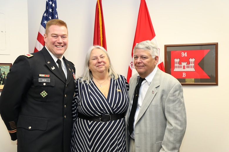 Former Transatlantic Division employee Jo-Ann Evans and her spouse James have an office call with TAD Commander Col. Christopher Beck. Evans was one of two individuals inducted into TAD's new Gallery of Distinguished Civilians during a ceremony held Feb. 20, 2020 at TAD's Headquarters in Winchester, Va.