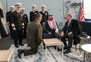 JEDDAH, Kingdom of Saudi Arabia (Feb. 16, 2020) Vice Adm. Jim Malloy, Commander of U.S. 5th Fleet, second left, Lt. Col. Todd Moulder, kneeling, His Royal Highness Prince Sultan Bin Ahmed Bin Abdulaziz Al Saud, second right, and H. Delano Roosevelt, executive director of the U.S. Saudi Business Council and Franklin Delano Roosevelt's grandson, pose during the 75th Anniversary ceremony of the Quincy meeting between President Franklin D. Roosevelt and King Ibn Saud, aboard the guided-missile destroyer USS Farragut (DDG 99) to recreate a photo from the original Quincy Agreement between President Roosevelt and King Abdul Aziz Ibn Saud of Saudi Arabia. The ceremony was held in recognition of the original Quincy Agreement which took place aboard the USS Quincy (CA-71) between U.S. President Franklin D. Roosevelt and King Abdul Aziz of Saudi Arabia Feb. 14, 1945. (U.S. Navy photo by Mass Communication Specialist 3rd Class Dawson Roth)