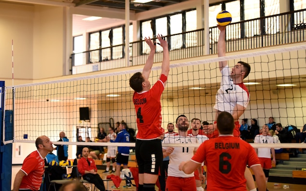 A member of the Polish air force spikes a volleyball during the 2020 Allied Air Command Inter-Nation Volleyball Championship at RAF Mildenhall, England, Feb. 19, 2020. This international sports championship brought together the contributing nations within Allied Air Command with an opportunity for friendly sporting competition. (U.S. Air Force photo by Senior Airman Brandon Esau)