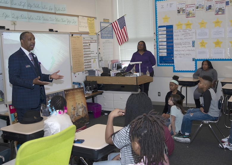 Man speaks to 5th graders about diversity and respect
