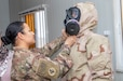 A U.S. Army Soldier (left), with 113 Financial Management Support Detachment, 101st Airborne Division, assists a Jordan Armed Forces-Arab Army Quick Reaction Force Female Engagement Team Soldier with donning protective gear during a Chemical, Biological, Radiological and Nuclear Subject Matter Expert Exchange coordinated by fellow Soldiers, with 655 Regional Support Group, 316 Sustainment Command (Expeditionary), 377 Theater Sustainment Command, and the Canadian Armed Forces at a base outside of Amman, Jordan in February. Without regard to its appearance, Soldiers must be ready and capable to conduct the full range of military operations to defeat all enemies regardless of the threats they pose. (U.S. Army photo by Sgt. 1st Class Shaiyla B. Hakeem)