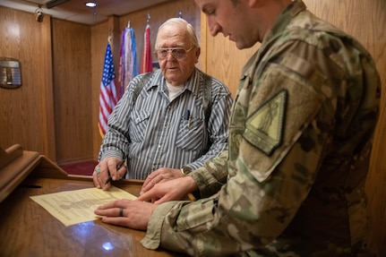 Veteran takes his Oath of Enlistment at the age of 79
