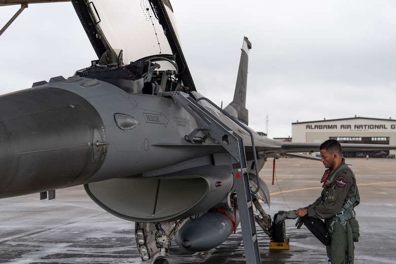 Photo of 1st Lt. Lucas Brown, F-16 pilot with the 377th Fighter Squadron, preparing to fly.