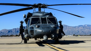 An HH-60G Pave Hawk sits on the flightline