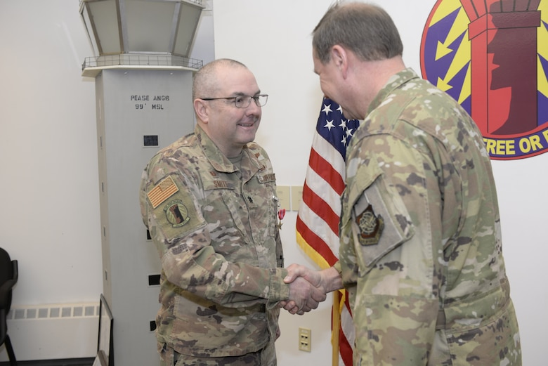New Hampshire Air National Guard Col. Mark Ustaszewski, 157th Operations Group, right, congratulates Lt. Col. Charles Smith, 260th Air Traffic Control Squadron commander, after pinning the U.S. Air Force Bronze Star Medal on Smith during a ceremony at Pease Air National Guard Base, N.H., Feb. 9, 2020. Smith was awarded the Bronze Star Medal for his meritorious achievement as Commander, 44rd Air Expeditionary Squadron, Al Asad Air Base, Iraq, while engaged in operations against an opposing armed force from 2 April 2019 through 6 October 2019. (U.S. Air National Guard photo by Tech. Sgt. Aaron Vezeau)