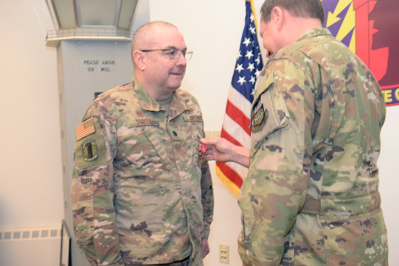 New Hampshire Air National Guard Col. Mark Ustaszewski, 157th Operations Group, right, pins the U.S. Air Force Bronze Star Medal on Lt. Col. Charles Smith, 260th Air Traffic Control Squadron commander,  during a ceremony at Pease Air National Guard Base, N.H., Feb. 9, 2020. Smith was awarded the Bronze Star Medal for his meritorious achievement as Commander, 44rd Air Expeditionary Squadron, Al Asad Air Base, Iraq, while engaged in operations against an opposing armed force from 2 April 2019 through 6 October 2019. (U.S. Air National Guard photo by Tech. Sgt. Aaron Vezeau)