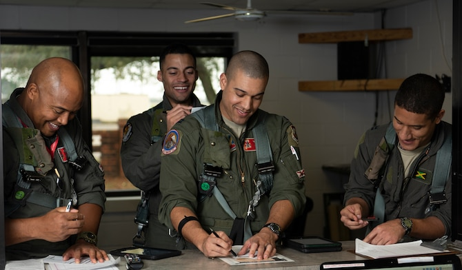 Photo of pilots preparing for sortie.
