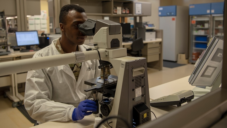 Staff Sgt. Edward Thompson, NCO in charge of Hematology and Urinalysis at the 6th Medical Group, looks at a sample through a microscope, Feb. 18, 2020, at MacDill Air Force Base, Fla. Using the microscope, Thompson looks at red blood cells, white blood cells, and platelets checking for abnormalities, which allows him to determine if a patient has a disease such as Malaria or Lukemia.