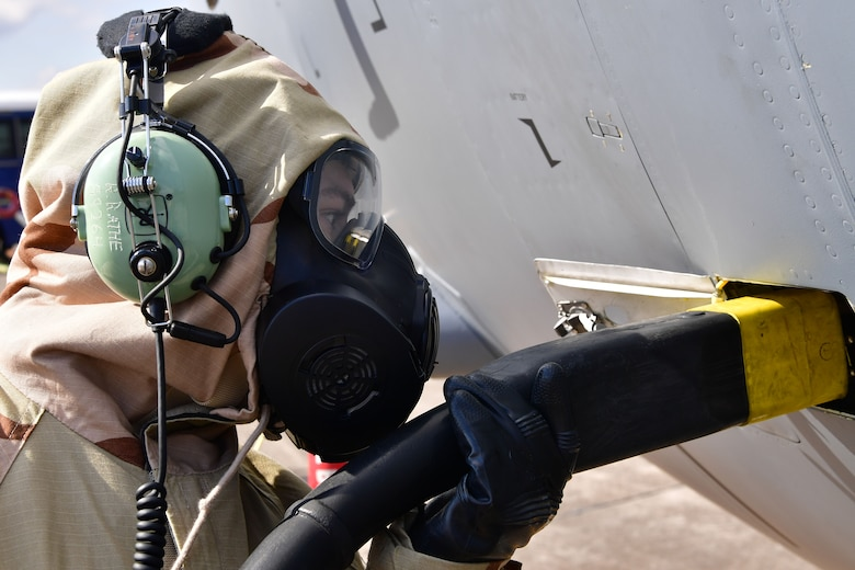 An Airman from the 19th Aircraft Maintenance Squadron connects power to a C-130J Super Hercules.