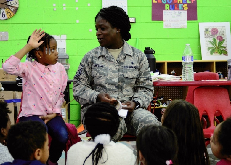 A Master Sgt. answers a question during an event at the Kirtland Youth Center.