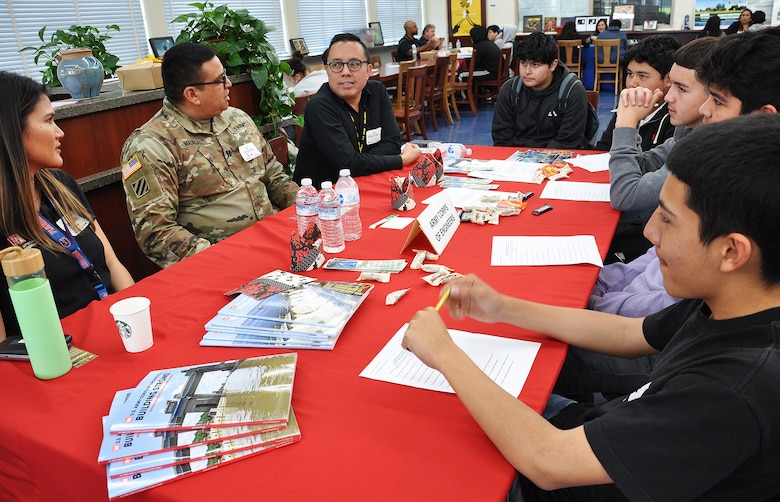 From left, U.S. Army Corps of Engineers Los Angeles District employees Jenna May, Capt. Gus Madrigal and Linh Do talk about their careers with ninth to 12th grade students Feb. 12 during John Muir High School's Engineering and Environmental Science Academy Career Exploration Showcase in Pasadena, California.