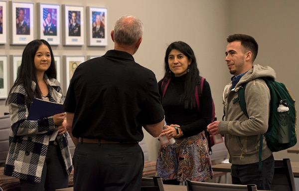 University of New Mexico students speak with Reginald Bourgeois, USACE-Albuquerque District STEM outreach coordinator, during a STEM outreach event hosted by the U.S. Army Corps of Engineers-Albuquerque District at the USACE-Albuquerque District headquarters office, Feb. 20, 2020. Bourgeois was discussing his experiences with the USACE National Power Team in Puerto Rico after Hurricane Maria.