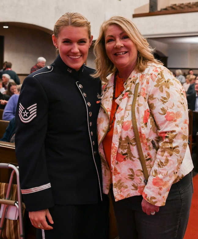 Tech. Sgt. Nadia Sosnoski, U.S. Air Force Band Singing Sergeants soprano, poses for a photo with her mother in La Jolla, Ca., Feb. 11, 2020. The concert was the first time Sosnoski was able to see her mother since returning from a 102-day deployment to Al Udeid Air Base, Qatar which took her to eight countries. (U.S. Air Force photo by Airman 1st Class Spencer Slocum)