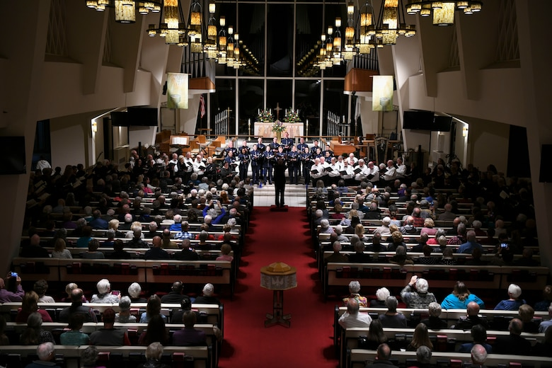 Members of the United States Air Force Band Singing Sergeants perform with communal choir members in San Diego, Ca., Feb. 17, 2020. The Singing Sergeants honor those who have served, inspire American citizens to heightened patriotism and service, and connect with the global community on behalf of the U.S. Air Force Band and the United States. (U.S. Air Force photo by Airman 1st Class Spencer Slocum)