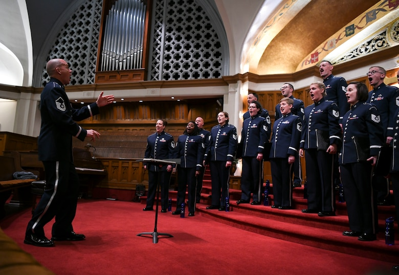 Master Sgt. Taylor Armstrong, U.S. Air Force Band Singing Sergeants conductor and vocalist, directs the band in Redlands, Ca., Feb. 14, 2020. Armstrong is the only enlisted conductor in the Air Force Band, all others being officers. (U.S. Air Force photo by Airman 1st Class Spencer Slocum)