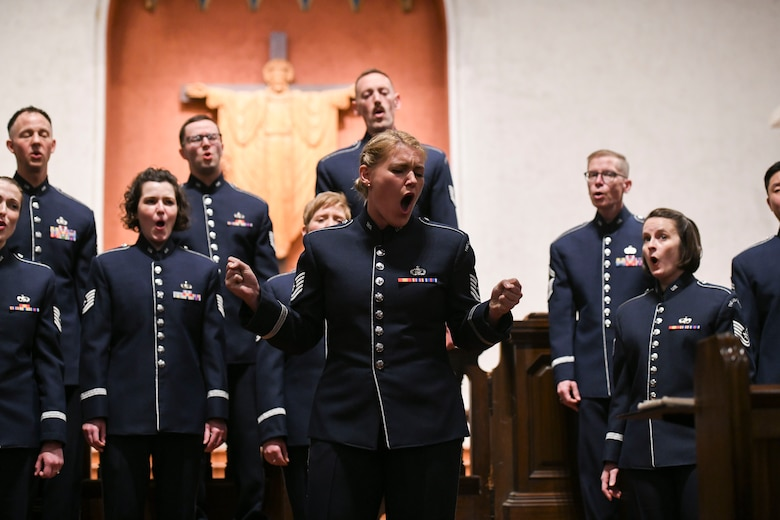 """Tech. Sgt. Nadia Sosnoski, U.S. Air Force Band Singing Sergeants soprano, sings a solo during """"Hallelujah"""" in La Jolla, Ca., Feb. 15, 2020. The tour through California was Sosnoski's first tour with the ensemble since joining in 2019. (U.S. Air Force photo by Airman 1st Class Spencer Slocum)"""