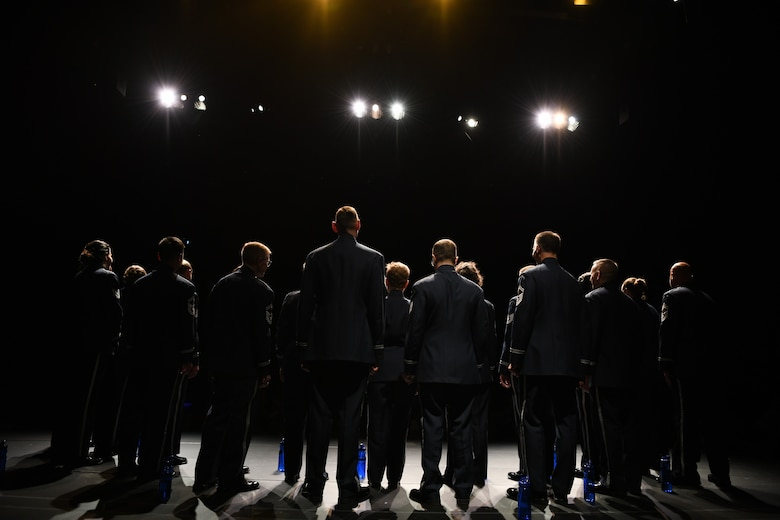 """Members of the United States Air Force Band Singing Sergeants receive a standing ovation after a performance at the Antelope Valley College Performing Arts Theatre in Lancaster, Ca., Feb. 14, 2020. The singers performed a set of over 10 songs, one of which, entitled """"Freedom Song"""", was arranged by Senior Master Sgt. Benjamin Park, the Singing Sergeants superintendent and a bass vocalist. (U.S. Air Force photo by Airman 1st Class Spencer Slocum)"""