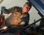 Senior Airman Thomas Bourgault, 103rd Logistics Readiness Squadron vehicle maintenance journeyman, checks the oil on a pickup truck at Bradley Air National Guard Base, East Granby, Conn. Feb. 8, 2020. Vehicle maintenance specialists perform scheduled maintenance and necessary repairs to Bradley's entire fleet of vehicles, ensuring readiness of organizations throughout the installation, including aircraft maintenance and fire and emergency services. (U.S. Air National Guard photo by Staff Sgt. Steven Tucker)