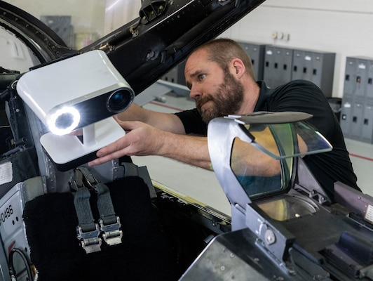 person 3D scanning an F-16