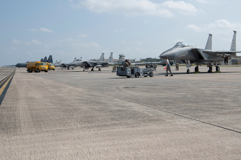 U.S. Air Force Airmen and U.S. Marines refuel and rearm F-15C Eagles, from Kadena Air Base, Japan, during an Agile Combat Employment exercise Feb. 21, 2020, at Marine Corps Air Station Futenma, Japan. Exercises that test our multi-capable Airmen and joint partners to provide munition loading and tactical refueling with minimal support are integral to employing precise ACE concept practices. (U.S. Air Force photo by Senior Airman Rhett Isbell)