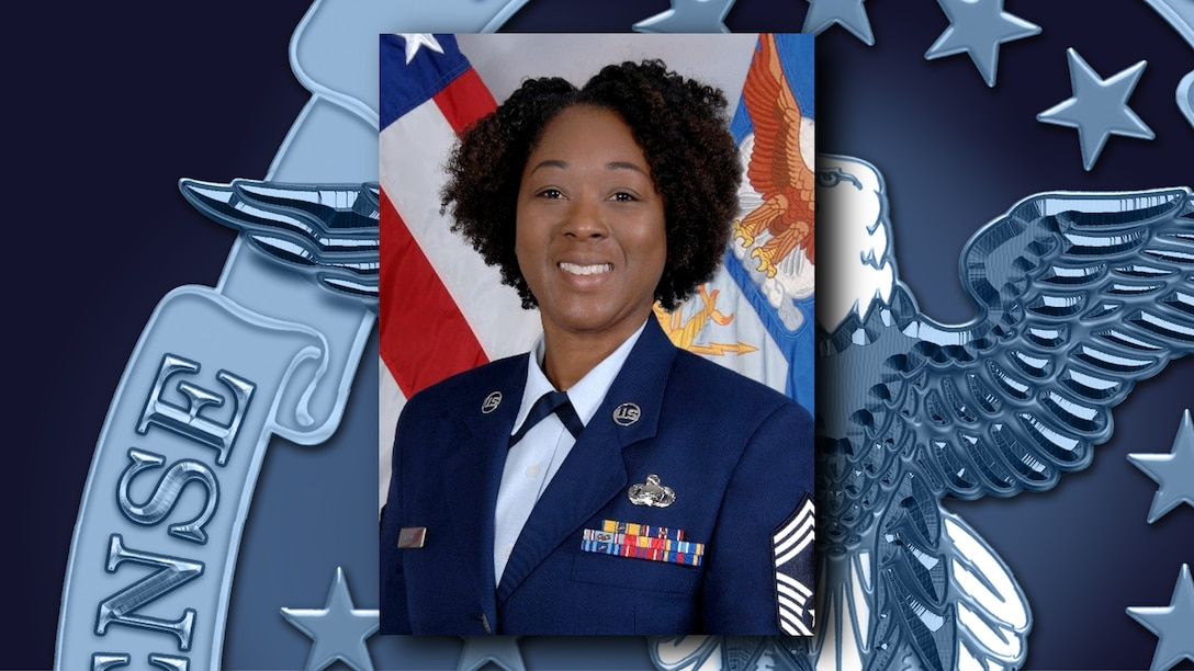 Black woman poses in front of US flag wearing Air Force dress uniform