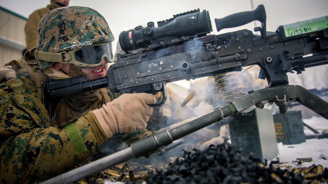 Lance Cpl. Matthew M. DeForge, a motor vehicle operator with 7th Engineer Support Battalion, 1st Marine Logistics Group, engages a target with a M240-B machine gun during a machine gun range at Fort Greely, Alaska, Feb. 22.