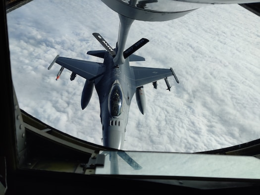 An F-16 Fighting Falcon aircraft is refueled by a KC-135 Stratotanker aircraft over Texas.