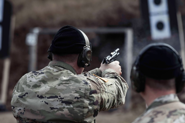 U.S. Army Soldiers take turns firing the M9 at targets during the Urban Rifle Marksmanship portion of the Master Marksmen Trainer Course at Joint Base Langley-Eustis, Virginia, Jan. 27, 2020.