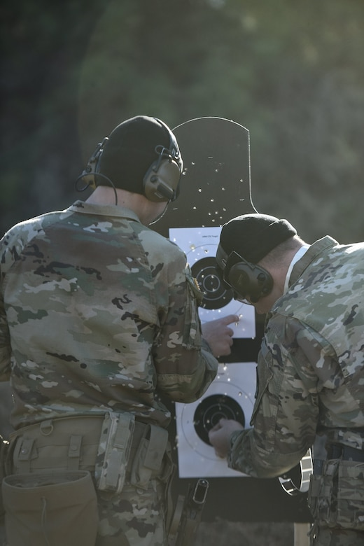 U.S. Army Soldiers participating in the Master Marksmanship Course Trainer program, check their targets for firing accuracy at Joint Base Langley-Eustis, Virginia, Jan. 27, 2020.