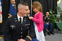 2nd Lt. Ted Baker, NHARNG, is pinned by his daughter, Norah, at a commissioning ceremony in Concord, Sept. 6, 2019.